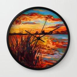 Sunset over lake Wall Clock