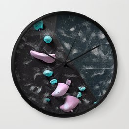 Dark night free climbing gym bouldering walls with boulder holds in pink and blue Wall Clock