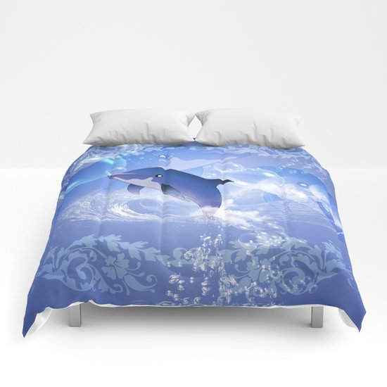 Funny cartoon dolphin Comforters