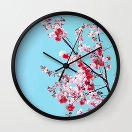 Red Rose Sakura on Bright Blue Background Wall Clock