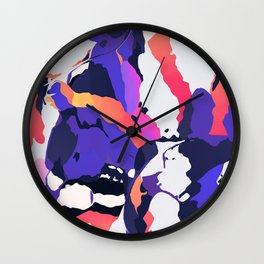 The purple color is turning peachy Wall Clock