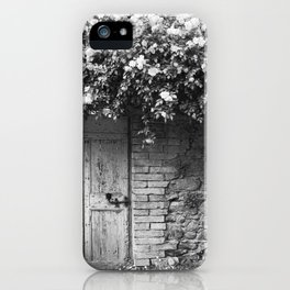 Old Italian wall overgrown with roses iPhone Case