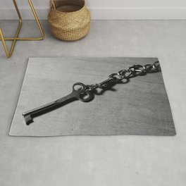 Old skeleton key on the chain Rug