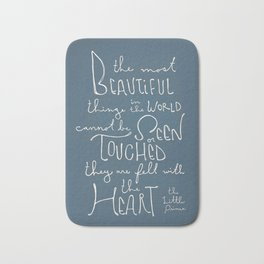 "The Little Prince quote ""the most beautiful things"" Bath Mat"