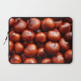 Glossy red conkers in autumn Laptop Sleeve