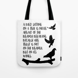 A bird sitting on a tree Tote Bag