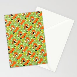 A pair of foxes on field. One stretches, the other licks his paw.  Stationery Cards