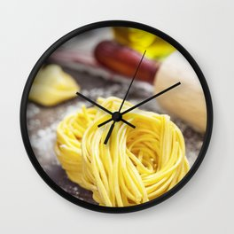 Making homemade pasta on wooden table Wall Clock