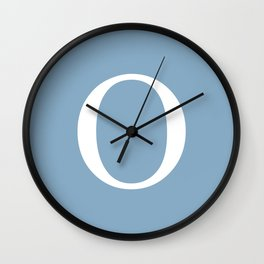 Letter O sign on placid blue background Wall Clock