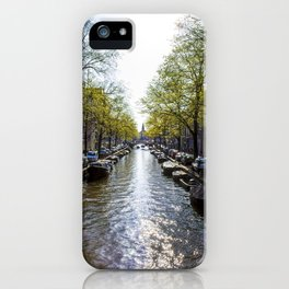 Sun Shining on a Row of Spring Trees Lining the Keizersgracht Canal in Amsterdam, Netherlands iPhone Case