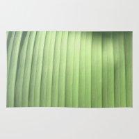 banana leaf Area & Throw Rugs featuring Banana Leaf Close by Glenn Designs