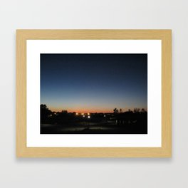 A city at twilight Framed Art Print