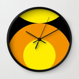Two suns, one yellow with orange rays,the other orange with yellow rays,both floating in a black sky Wall Clock