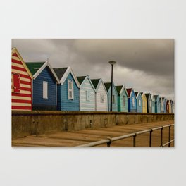 A row of beach cabins in the east of England Canvas Print