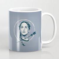 katniss Mugs featuring Katniss Stencil by Arne AKA Ratscape