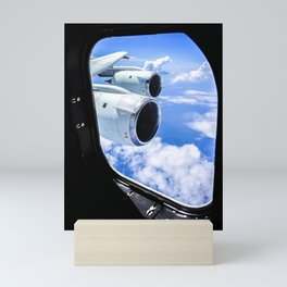 Cloud formations are seen through the window of NASA DC-8 aircraft during a flight over the Gulf of Mini Art Print
