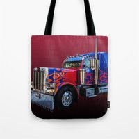 optimus prime Tote Bags featuring Optimus Prime Red by Steve Purnell