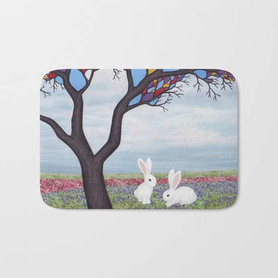 bunnies and the stained glass tree Bath Mat
