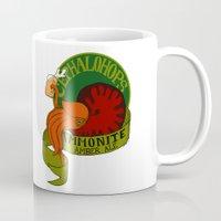 ale giorgini Mugs featuring Ammonite Amber Ale  by Caffeine and Carpal Tunnel
