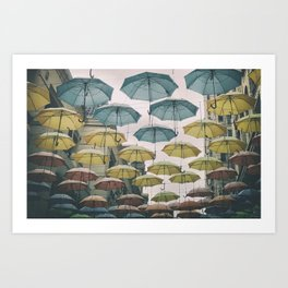 Umbrellas in the sky Art Print