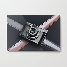 Vintage camera and films on black Metal Print