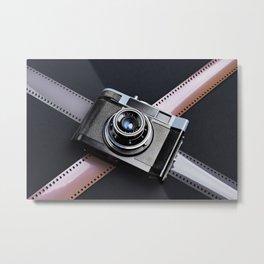 Vintage camera and films on black Metal Print