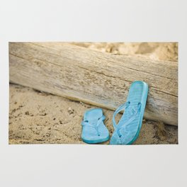 sandals against driftwood Rug