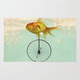 unicycle goldfish Rug