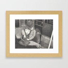 A couple on the subway Framed Art Print