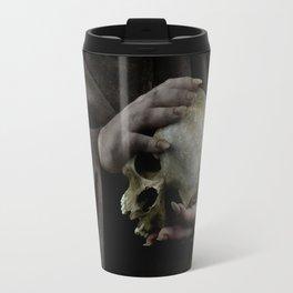 Holding a male skull Travel Mug