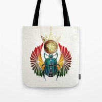 egyptian Tote Bags featuring egyptian beetle by Manoou
