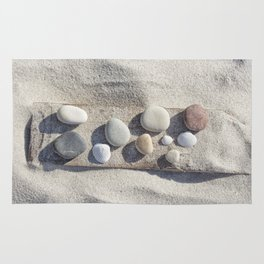 Beach pebble driftwood still life Rug
