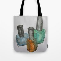 nail polish Tote Bags featuring Nail Polish Bottles by Brodie Fairall