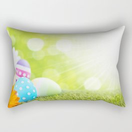 Decorated Easter eggs in the grass with a green background Rectangular Pillow