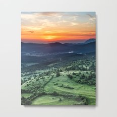 Beautiful sunset behind green fields Metal Print