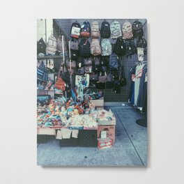 backpack and toy shop on the footpath Metal Print