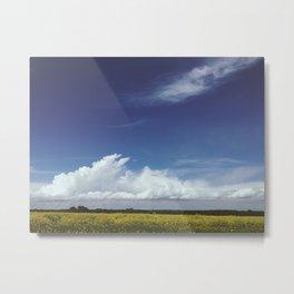 Clouds over field of rapeseed Metal Print