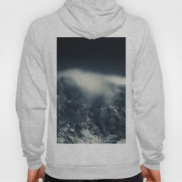 Darkness and white clouds over the mountains Hoody