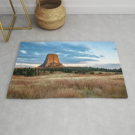 Devils Tower - Giant Monolith Drenched in Sunlight on Autumn Day in Wyoming Rug