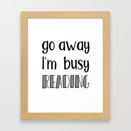 Go away, I'm busy reading! Framed Art Print