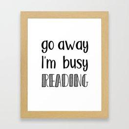 Go away, I'm busy reading! Framed Art Print