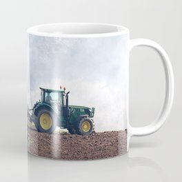 Tractor harrowing farm field Coffee Mug