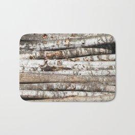 striped birch trunks Bath Mat