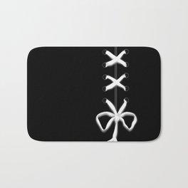 Laced White Ribbon on Black Bath Mat