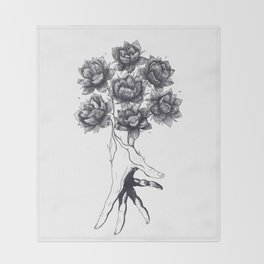 Hand with lotuses Throw Blanket