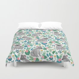 Cute gray koalas with ornaments, tropical flowers and leaves. Seamless tropical pattern. Duvet Cover