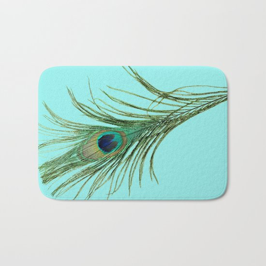 Peacock Feather on Blue Background Bath Mat