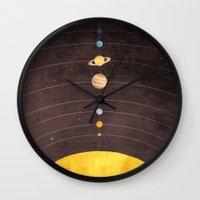 solar system Wall Clocks featuring Solar System by Annisa Tiara Utami