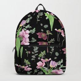 Spring flowers on black background Backpack