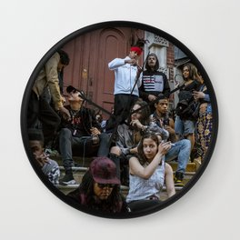 People Sitting on House Stairs, A Wall Clock